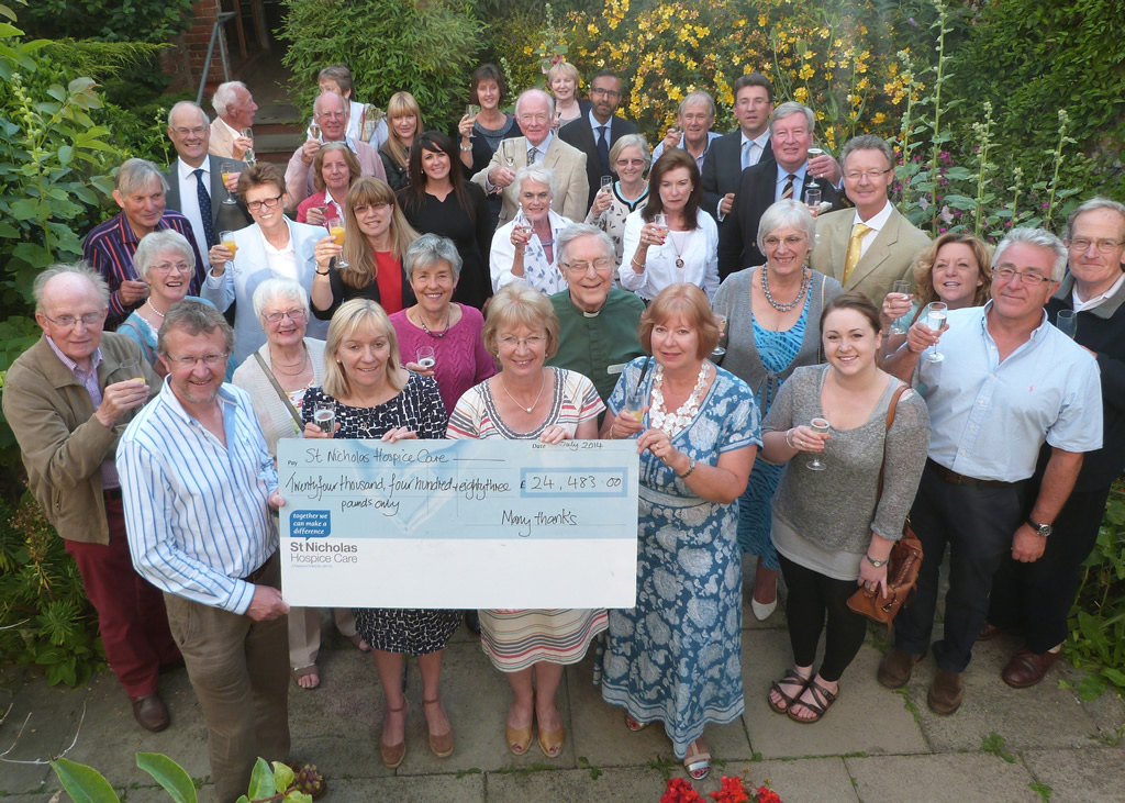 Hidden Gardens of Bury St Edmunds handing over cheque